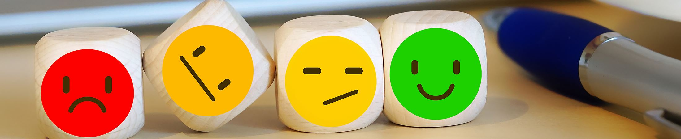 wooden blocks with emoji faces